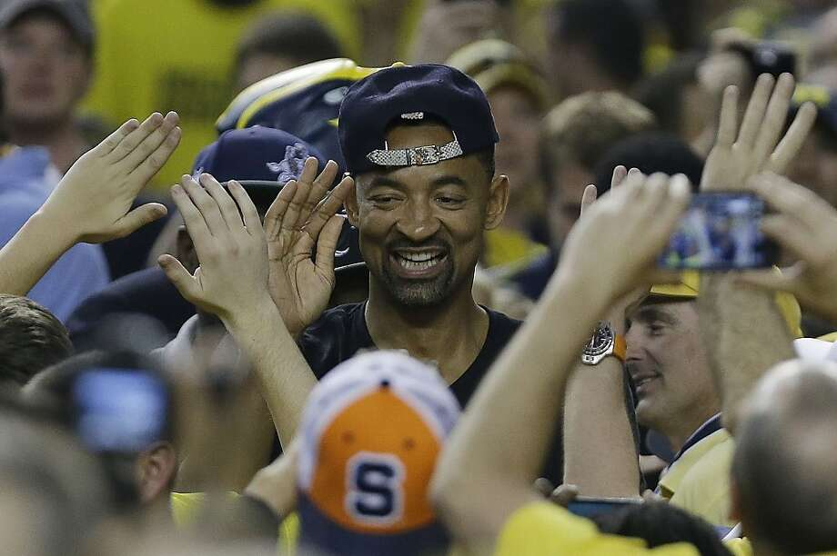 Former Michigan player Juwan Howard walks near the floor before the first half of the NCAA Final Four tournament college basketball championship game between Louisville and Michigan, Monday, April 8, 2013, in Atlanta. (AP Photo/Charlie Neibergall) Photo: Charlie Neibergall, Associated Press