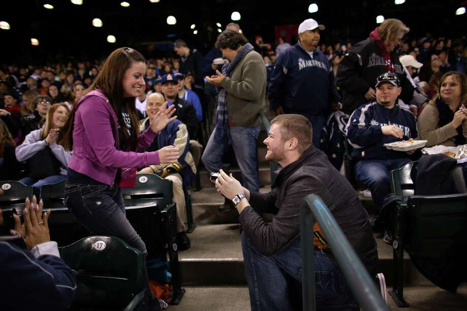 Matt Berzins proposes to his girlfriend HaleyMae Howells of Tacoma. Photo: JOSHUA TRUJILLO / SEATTLEPI.COM