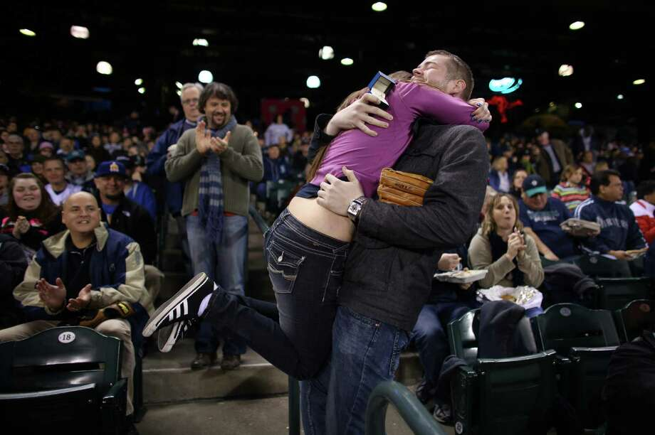 HaleyMae Howells of Tacoma embraces her boyfriend Matt Berzins after he proposed to her during opening day. Photo: JOSHUA TRUJILLO / SEATTLEPI.COM