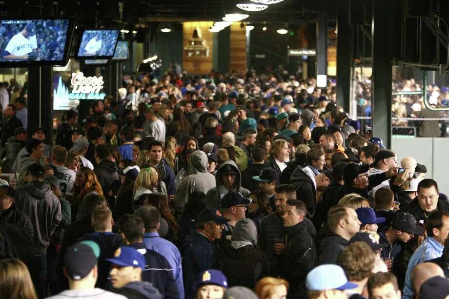 Fans crowd the new bullpen viewing area in left field. Photo: JOSHUA TRUJILLO / SEATTLEPI.COM
