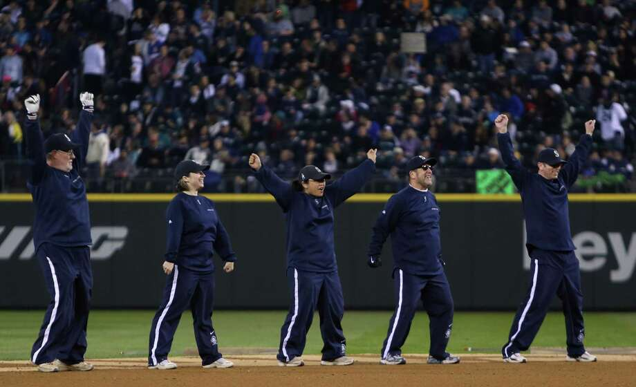 The grounds crew dances. Photo: JOSHUA TRUJILLO / SEATTLEPI.COM
