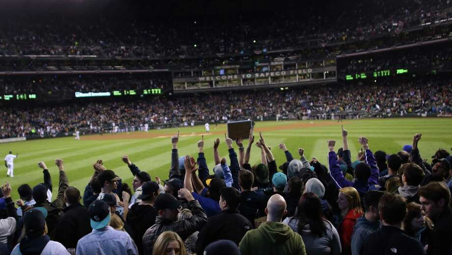 "Fans cheer in ""The Pen"" as the Mariners beat the Astros during the M's home opener on Monday, April 8, 2013 at Safeco Field in Seattle. The Mariners kicked off their 2013 home season against the Houston Astros. Photo: JOSHUA TRUJILLO / SEATTLEPI.COM"