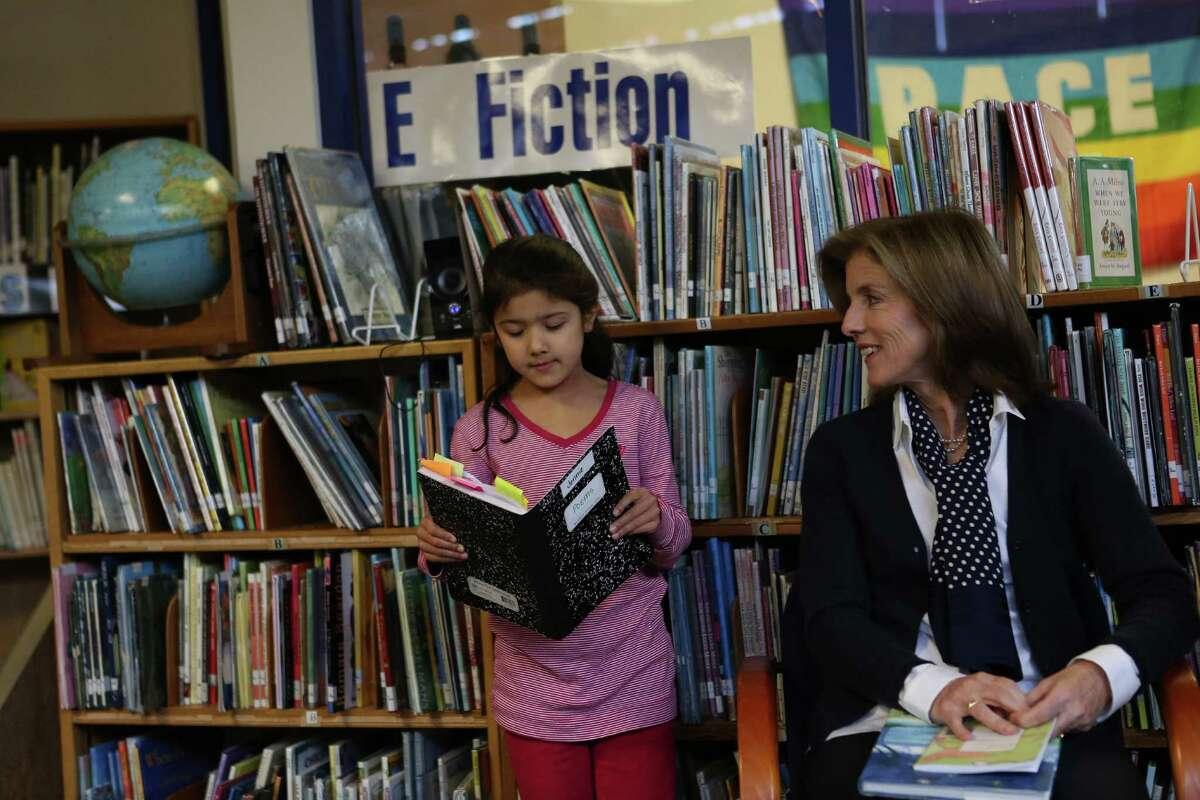 Caroline Kennedy Schlossberg, daughter of President John F. Kennedy, listens to poetry written by first-grader Janejira Brown at West Seattle's Sanislo Elementary School.