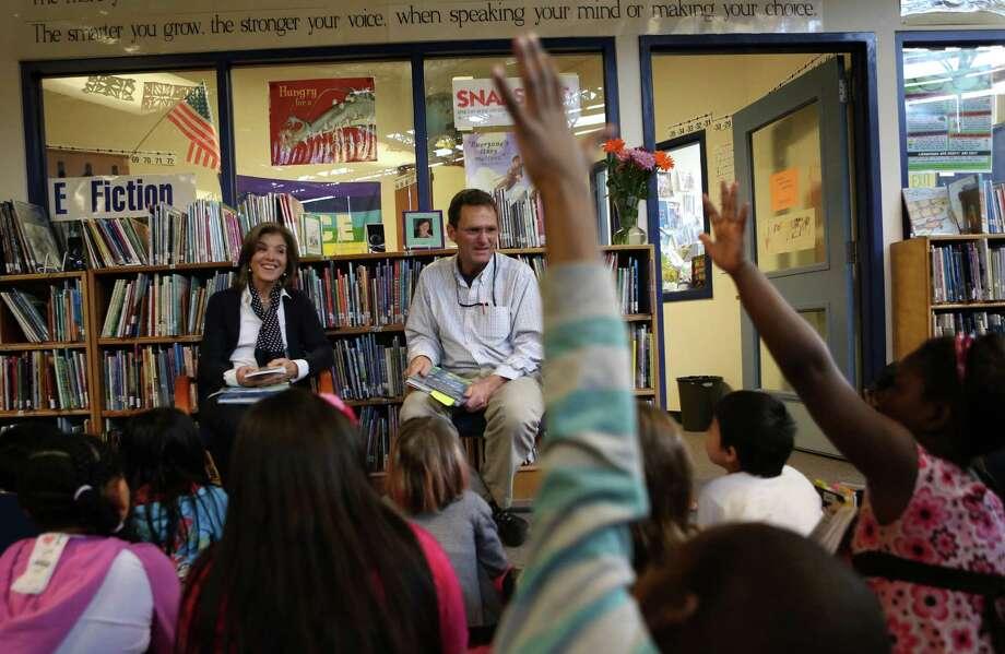 Caroline Kennedy Schlossberg, daughter of President John F. Kennedy, and librarian Craig Seasholes listen to poetry written by students at West Seattle's Sanislo Elementary School. Photo: JOSHUA TRUJILLO / SEATTLEPI.COM