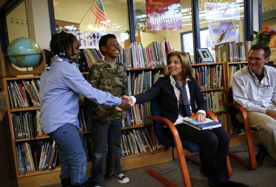 Caroline Kennedy Schlossberg, daughter of President John F. Kennedy, greets third-grade poetry club members Cynta-Liyah Stelivan and Quinton Scovens at West Seattle's Sanislo Elementary School on Monday, April 8, 2013. Kennedy Schlossberg was in Seattle for a poetry event at Seattle First Baptist Church on Tuesday evening. But she first visited the students to listen to their poetry. Photo: JOSHUA TRUJILLO / SEATTLEPI.COM