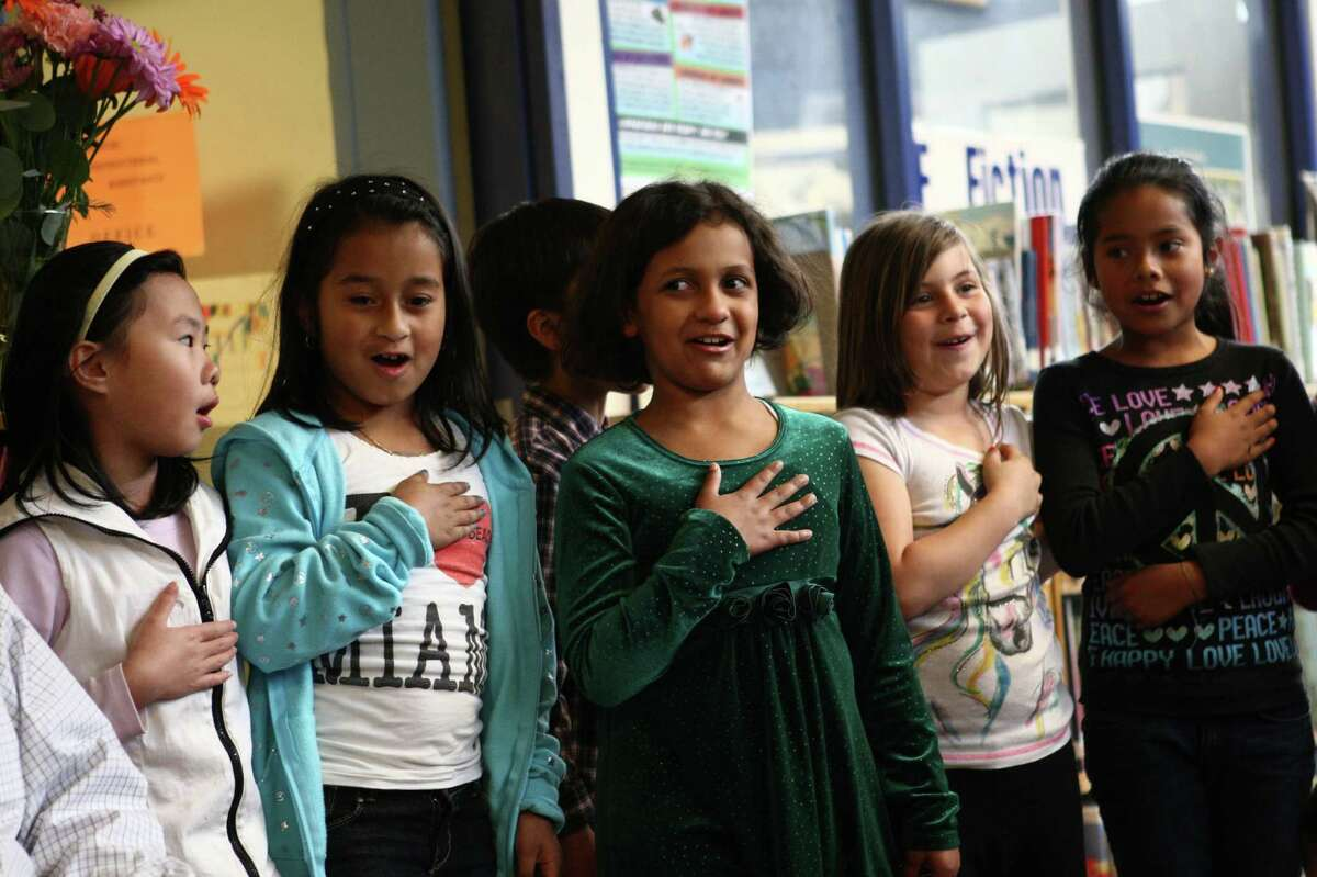 Students recite a poem to Caroline Kennedy Schlossberg, daughter of President John F. Kennedy, at West Seattle's Sanislo Elementary School.