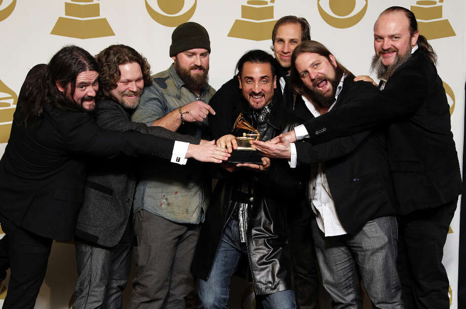 "The Zac Brown Band poses backstage with the award for Best Country Album for ""Uncaged\""at the 55th annual Grammy Awards on Sunday, Feb. 10, 2013, in Los Angeles. Photo: Matt Sayles, Matt Sayles/Invision/AP / Invision"