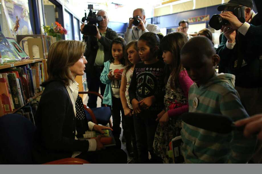 Caroline Kennedy Schlossberg, daughter of President John F. Kennedy, is surrounded by young students at West Seattle's Sanislo Elementary School. Photo: JOSHUA TRUJILLO / SEATTLEPI.COM