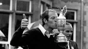 Tom Weiskopf, American golfer who acquired the nickname 'Towering Inferno' because of his height and his fits of anger, kissing the British Open Championship trophy following his win at Troon, Scotland.