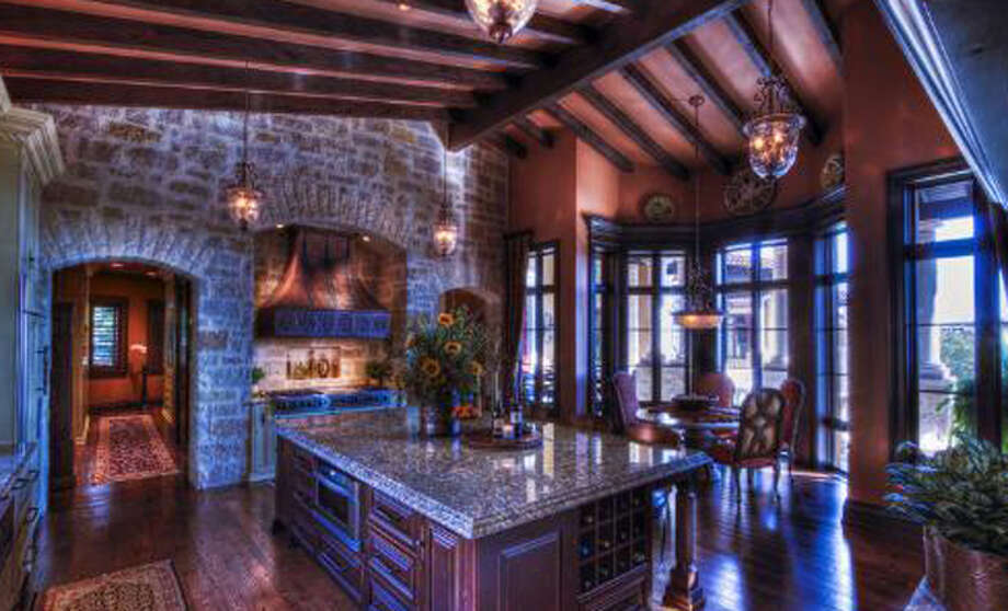 The kitchen at 14 Crescent Park, San Antonio, features granite countertops and a wine storage area.