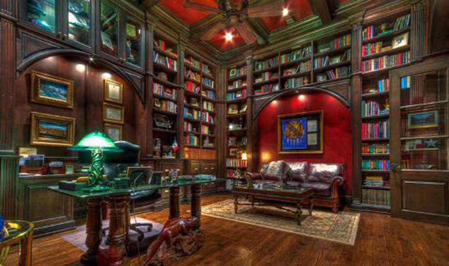 The library at 14 Crescent Park, San Antonio, offers built-in shelving.