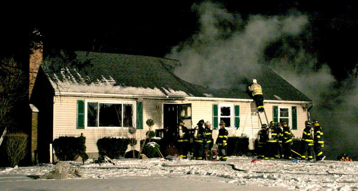 Firefighters battle a fire at 34 Paper Mill Road, Jan. 5, 2009