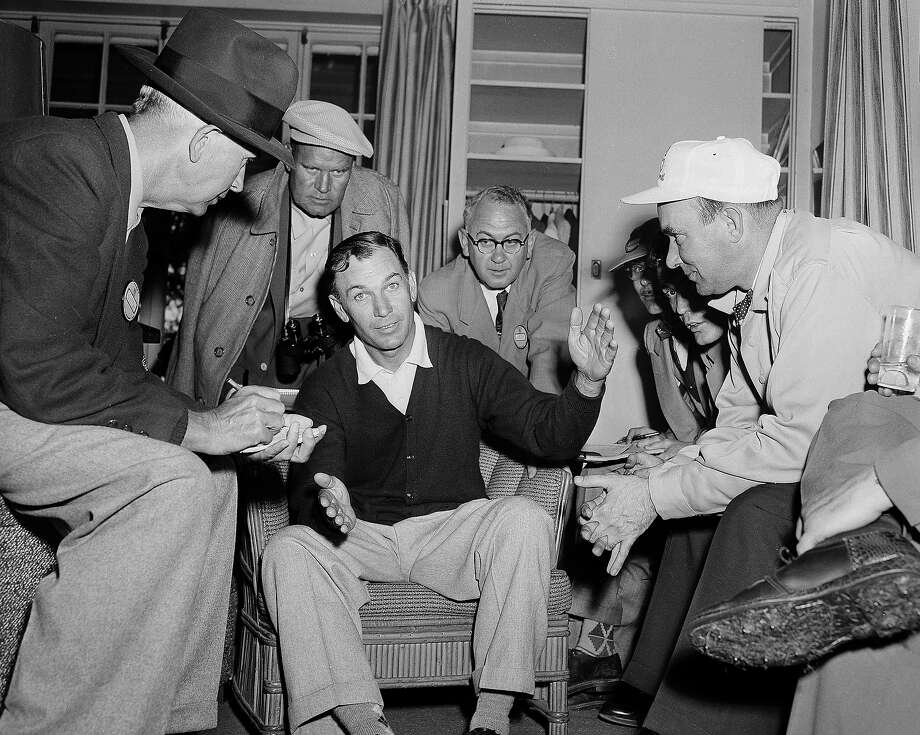 Pro golfer Ben Hogan is interviewed by the press after third round of Augusta Masters Golf Tournament, April 10, 1954. Photo: Horace Cort, Associated Press / AP