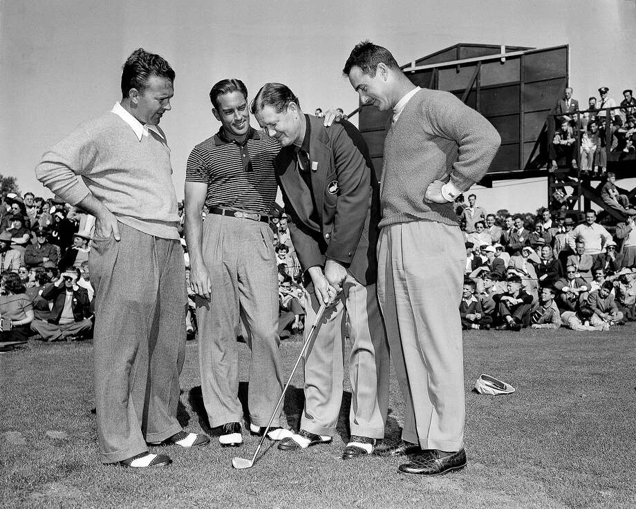 Byron Nelson of Roanoke, Tex., second from right, shows three amateurs how to make a chip shot in the Masters Golf tournament before play got underway at Augusta, Ga., April 6, 1949. His pupils are Gene Dahlbender, left, Frank Stranahan and Skee Riegel. This is the only tourney in which Nelson plays. He is a former champion of the Masters. Photo: Associated Press / AP