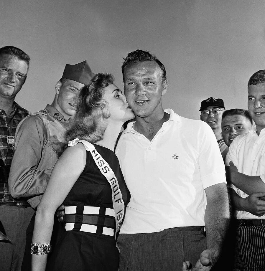 Arnold Palmer poses with Miss Golf 1959 Andrea Little after third round of Masters on April 4, 1959 at Augusta. Photo: Anonymous, Associated Press / A1959
