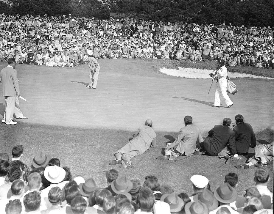 Sam Snead sinks a 20-foot putt on the 18th green to win the Masters Tournament in Augusta, Ga., April 10, 1949. Photo: Rudolph Faircloth, Associated Press / AP