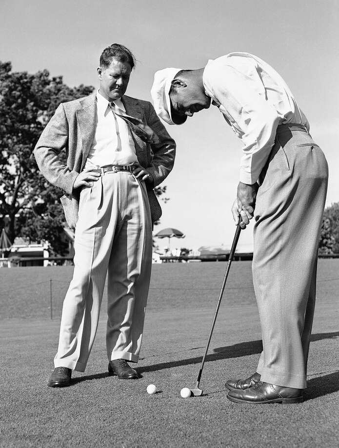Byron Nelson (left) watches Ben Hogan putting on the Augusta National Course, Augusta, Ga., on April 3, 1946 as the two former Texas carries prepare for the Masters Golf Tournament. Nelson, winner of the last Masters, played in 1942, and Hogan, who had a 70 in his last practice round before the tournament, are co-favorites to win the $2,500 first prize.  Tournament starts on April 4th. Photo: Associated Press / AP1946