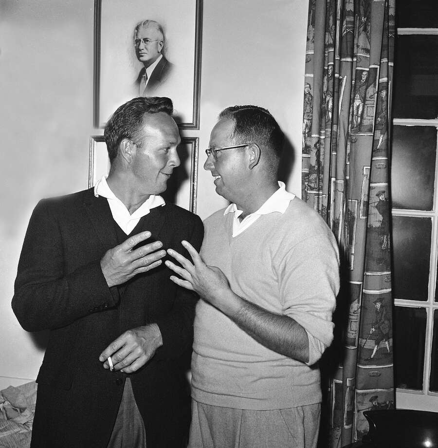 Arnold Palmer, left, and Bob Rosburg compare first round Masters scores and find both are four-under-par with 68s and lead the field after the first round of golf, April 7, 1961, Augusta, Ga. Photo: Horace Cort, Associated Press / AP1961