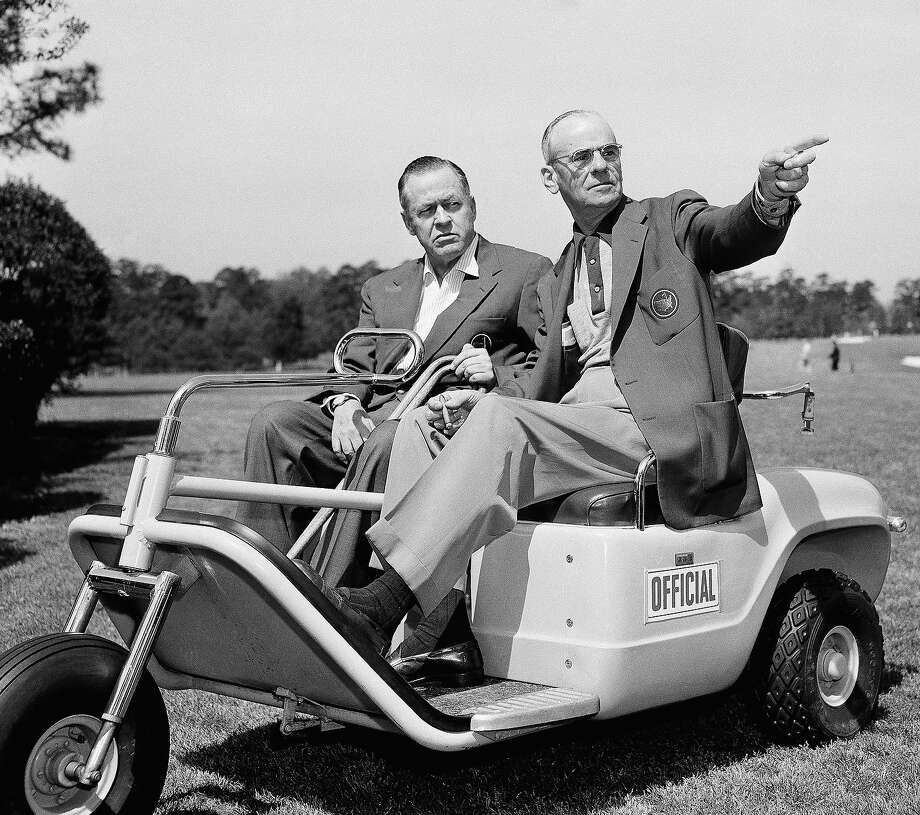 Looking over the Augusta National course iin Augusta, Ga.- scene of the Masters -here Apr. 3, 1957 are Bobby Jones (left), all time golfing great and Cliff Roberts, tournament chairman. Photo: Horace Cort, Associated Press / 1957 AP