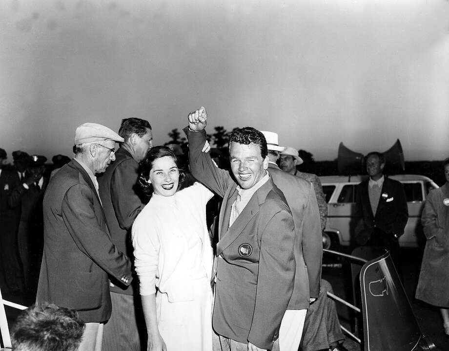 Jack Burke, Jr., wearing his championship jacket, cheers with his wife, Eilene, after winning the Masters Golf Tournament at the Augusta National Golf Club in Augusta, Ga., April 8, 1956.  Burke won with a total score of 289. Photo: Associated Press / AP1956