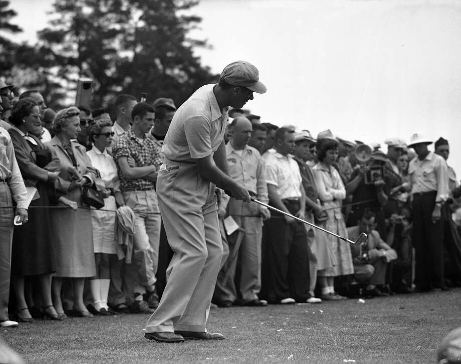 Cary Middlecoff rolls his ball from the edge of the green during the third round of Masters Golf Tournament in Augusta, Ga., April 9, 1955.  The shot missed by an inch. Photo: Horace Cort, Associated Press / AP1955