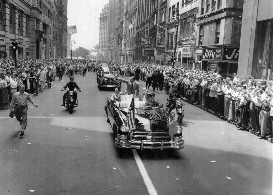 Exchange Alley in Manhattan's Wall Street District momentarily becomes Ben Hogan's alley as the golfer moves up lower Broadway seated on the back of an automobile July 21, 1953, passing cheering New Yorkers. The Texan who won the British Open golf title was en route to a City Hall reception. Earlier, Hogan also captured the Masters and U.S. Open titles. Photo: Associated Press / AP1953