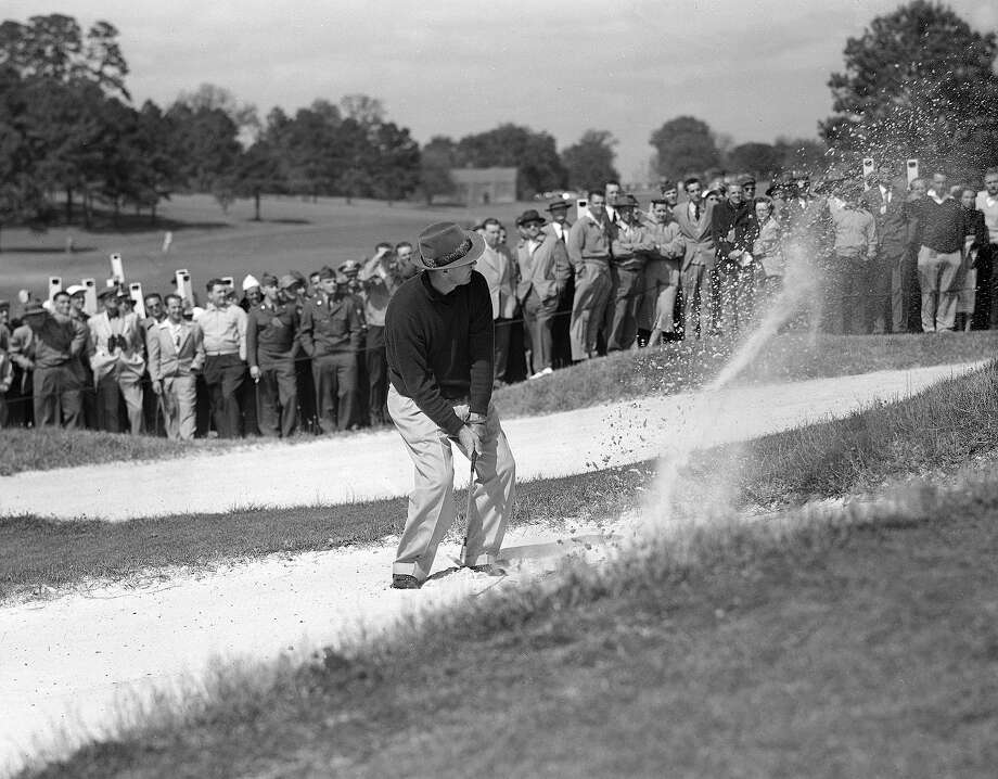 Sam Snead hits the ball from a sand trap on the seventh hole in the Masters Golf tournament in Augusta, Ga., April 5, 1952. Photo: HORACE CORT, Associated Press / 1952 AP