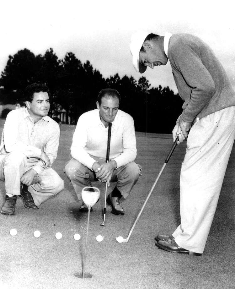 Tony Holquin, left, Mexico's Open champion, and Roberto De Vicenzo, Argentina's Open champion, watch Ben Hogan, former U.S. Open champion, on the practice green at the Augusta National Golf Club on April 5, 1950.  Golfers have come from all over the world to play at the Masters Tournament in Augusta, Ga. Photo: Associated Press / AP1950