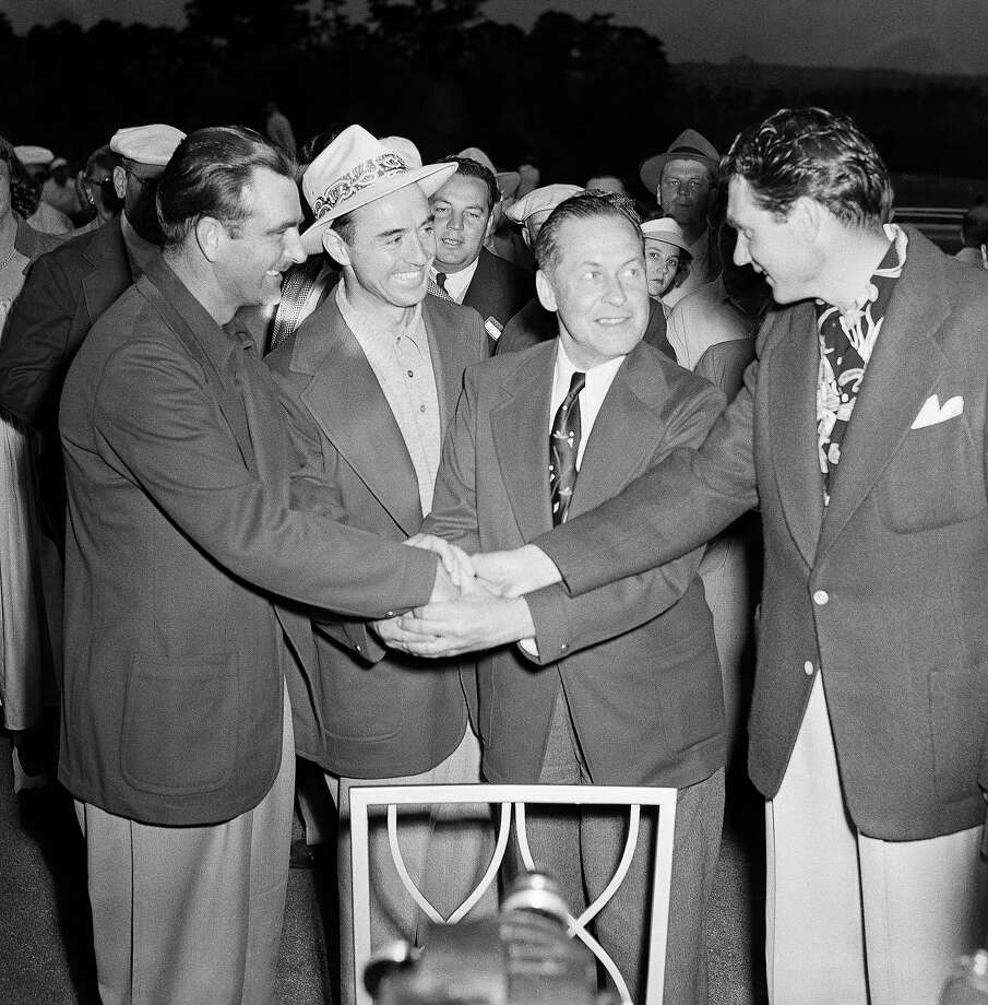 Bobby Jones (2nd from right) , president of the National Golf Club in Atlanta, Ga. presents the Masters Tournament winners Apr. 10, 1949, left to right: Lloyd Mangrum, tied for 2nd: Sam Sneed, winner: Jones: and John Bulla, tied for 2nd. Photo: Horace Cort, Associated Press / 1949 AP