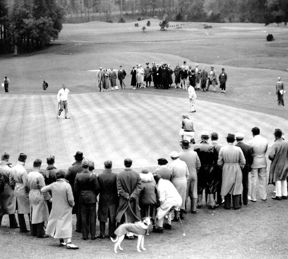 The Fairfield Museum and History Center is opening a new exhibition, Fairfield Fairways: 120 Years of Golf on June 11 - October 4. In light of this new exhibit, take a look at how golf evolved from its beginnings to today across all of Fairfield County. Visit Fairfiled Museum & History Center for more information. (Pictured: Gene Sarazen of Bridgeport, right, putts out on the last green and defeats Craig Wood, looking on at left, in a playoff during the Masters Championship at the Augusta National Golf Club, Ga., on April 8, 1935.)  Photo: Associated Press / 1935 AP