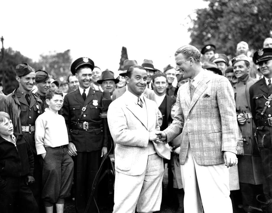 Gene Sarazen, left, is congratulated by Craig Wood of N.J., at the end of their 36-hole playoff game of the Masters Championship at Augusta National Golf Club, Ga., on April 8, 1935.  Sarazen won 144 to 149. Photo: Associated Press / AP1935