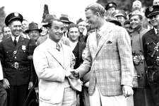 Gene Sarazen, left, is congratulated by Craig Wood of N.J., at the end of their 36-hole playoff game of the Masters Championship at Augusta National Golf Club, Ga., on April 8, 1935.  Sarazen won 144 to 149.