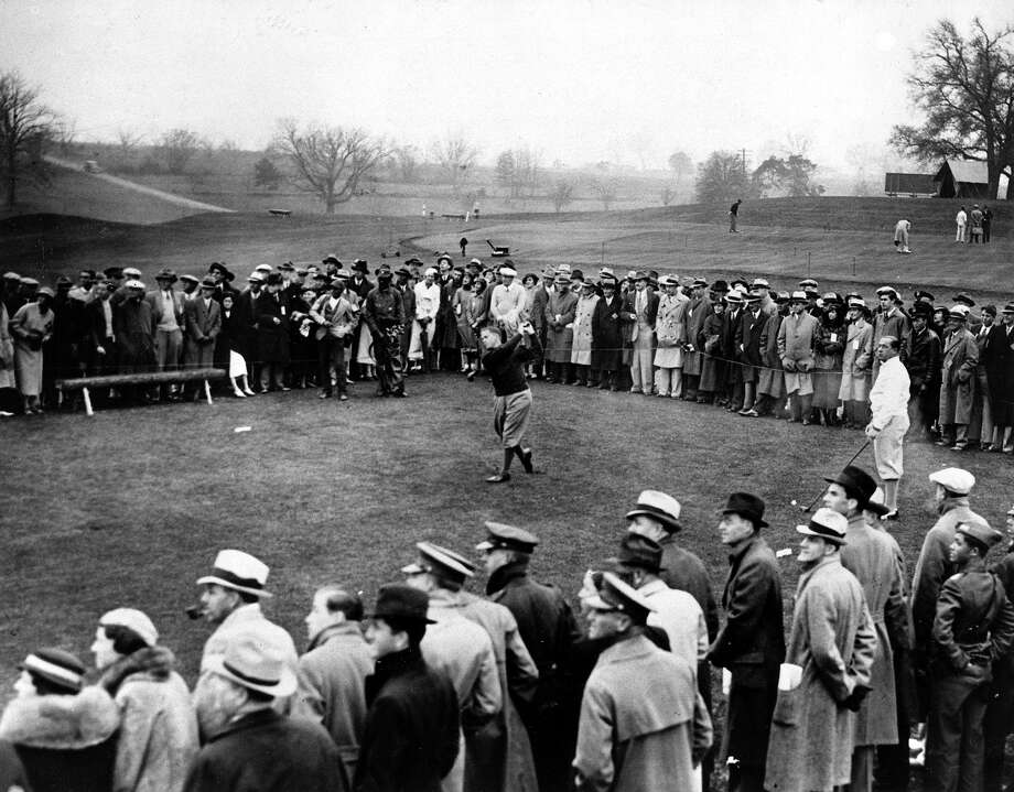Amateur golfer Bobby Jones is shown driving during the third day's play in the Masters Invitation Tournament at the Augusta National Golf Club in Augusta, Ga., March 24, 1934.  Jones carded par 72, but his 222 for the 54 holes left him in 18th place overall.  Walter Hagen looks on at right. Photo: Associated Press / AP1934