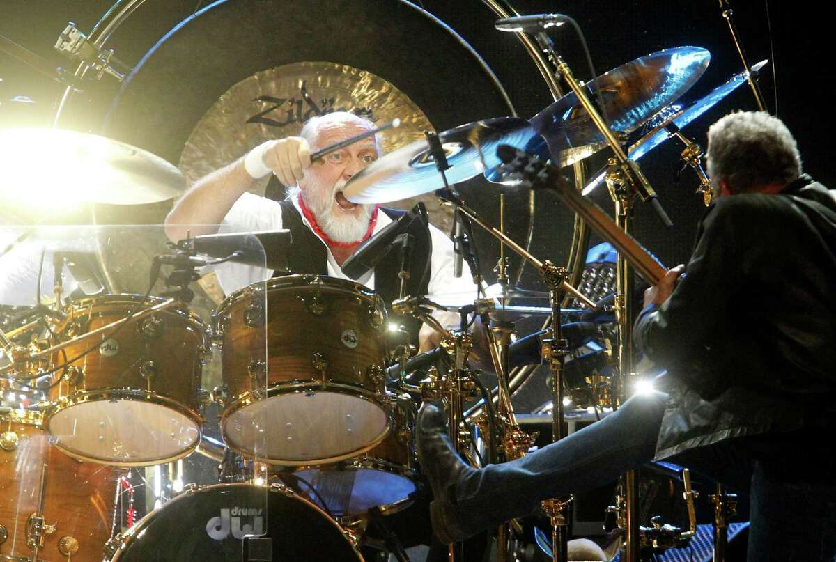 Drummer Mick Fleetwood and guitarist Lindsey Buckingham perform during a Fleetwood Mac concert at Madison Square Garden, Monday, April 8, 2013, in New York.