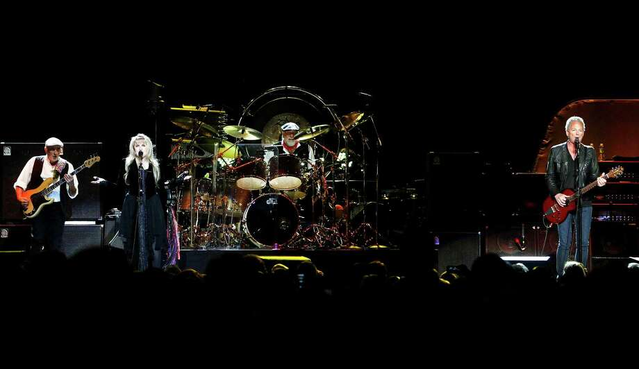 Members of Fleetwood Mac, from left, bassist John McVie, singer Stevie Nicks, drummer Mick Fleetwood and guitarist Lindsey Buckingham perform during a concert at Madison Square Garden, Monday, April 8, 2013, in New York. Photo: Jason DeCrow, Jason DeCrow/Invision/AP / Invision