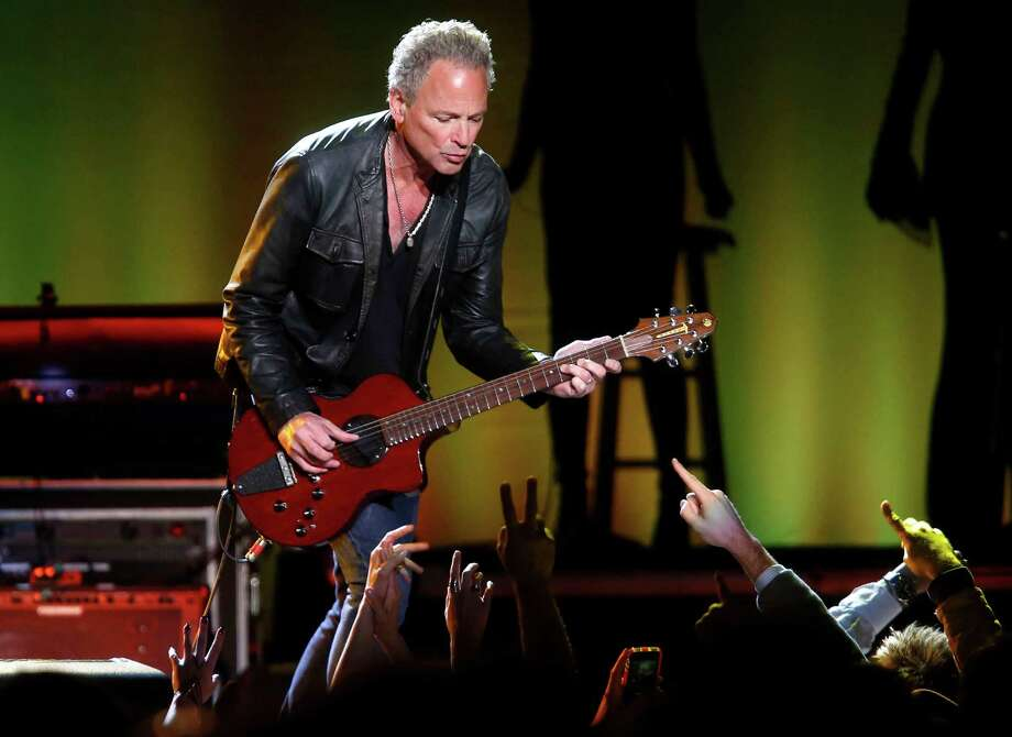 Guitarist Lindsey Buckingham performs during a Fleetwood Mac concert at Madison Square Garden, Monday, April 8, 2013, in New York. Photo: Jason DeCrow, Jason DeCrow/Invision/AP / Invision