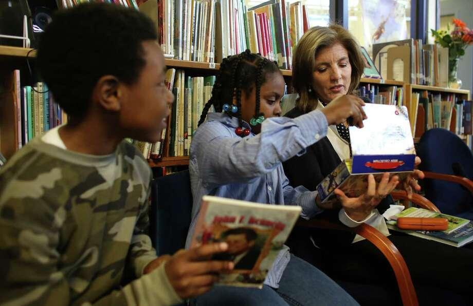 Caroline Kennedy Schlossberg, daughter of President John F. Kennedy, looks at poetry with third-grade poetry club members Cynta-Liyah Stelivan and Quinton Scovens, left, at West Seattle's Sanislo Elementary School. Photo: JOSHUA TRUJILLO / SEATTLEPI.COM