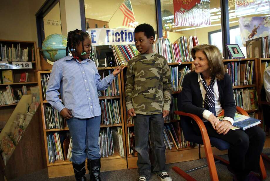 Caroline Kennedy Schlossberg, daughter of President John F. Kennedy, listens to poetry from third-grade poetry club members Cynta-Liyah Stelivan, left, and Quinton Scovens at West Seattle's Sanislo Elementary School. Photo: JOSHUA TRUJILLO / SEATTLEPI.COM