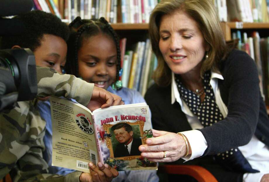 Caroline Kennedy Schlossberg, daughter of President John F. Kennedy, is shown a photo of herself by third-grade poetry club members Cynta-Liyah Stelivan and Quinton Scovens, left. She said that in the photo her mom was reading her a poem. Photo: JOSHUA TRUJILLO / SEATTLEPI.COM