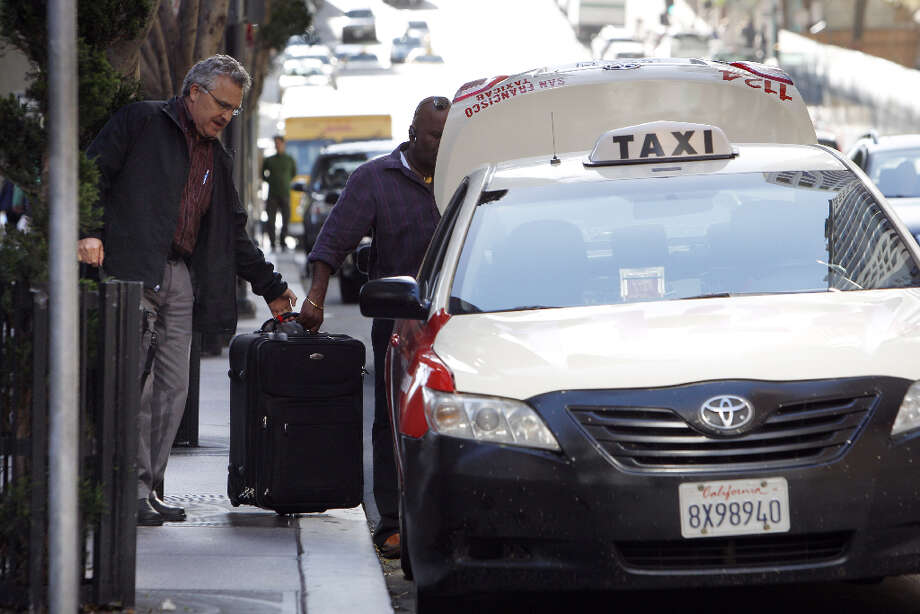 Steve Kline is helped into a cab at 555 California Street in San Francisco, Calif., on Monday, April 8, 2013. (Driver declined to give name). A report for the SFMTA by a taxi consultant says the city needs 600-800 more taxis. Photo: Carlos Avila Gonzalez, The Chronicle / ONLINE_YES