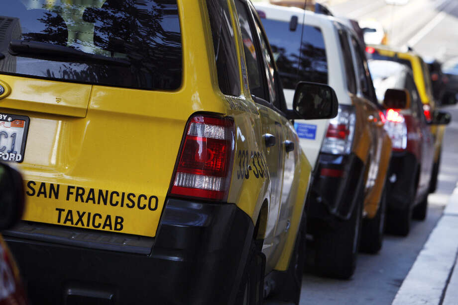Taxis line up in a taxi zone at 555 California Street in San Francisco, Calif., on Monday, April 8, 2013. A report for the SFMTA by a taxi consultant says the city needs 600-800 more taxis. Photo: Carlos Avila Gonzalez, The Chronicle / ONLINE_YES