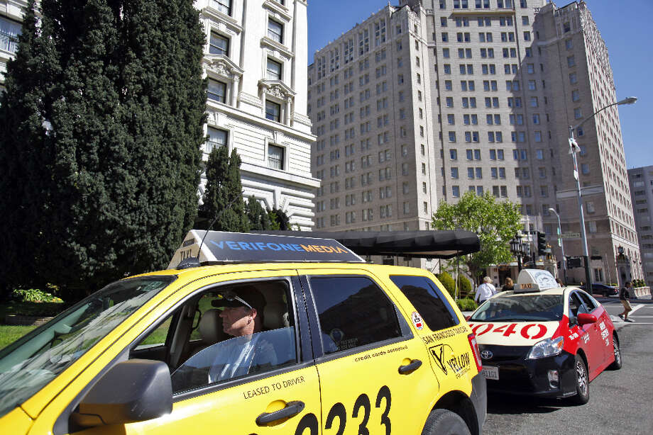 John Lyman, a cabbie for 14 years, sits in his cab waiting for customers at the Fairmont Hotel in San Francisco, Calif., on Monday, April 8, 2013. A report for the SFMTA by a taxi consultant says the city needs 600-800 more taxis. Photo: Carlos Avila Gonzalez, The Chronicle / ONLINE_YES