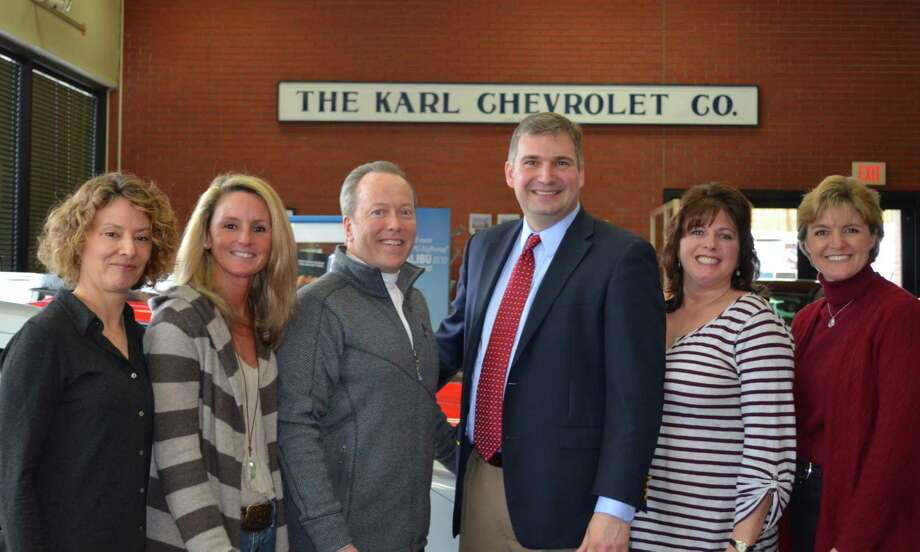 KARL Chevrolet kicked off its 28th annual April scholarship promotion, pledging to contribute $50 to the New Canaan High School Scholarship Foundation for each new or certified pre-owned vehicle sold or leased through April 30 to New Canaan residents or businesses. From left, Roberta Peet and Lisa Isherwood, co-chairmen of the New Canaan High School Scholarship Foundation's Finance Committee; Leo E. Karl III, president of Karl Chevrolet; Bryan Luizzi, New Canaan High School principal; Mary DiCosmo, NCHS Scholarship Foundation; and Anne Trinklein, NCHS drive publicity volunteer. Photo: Contributed