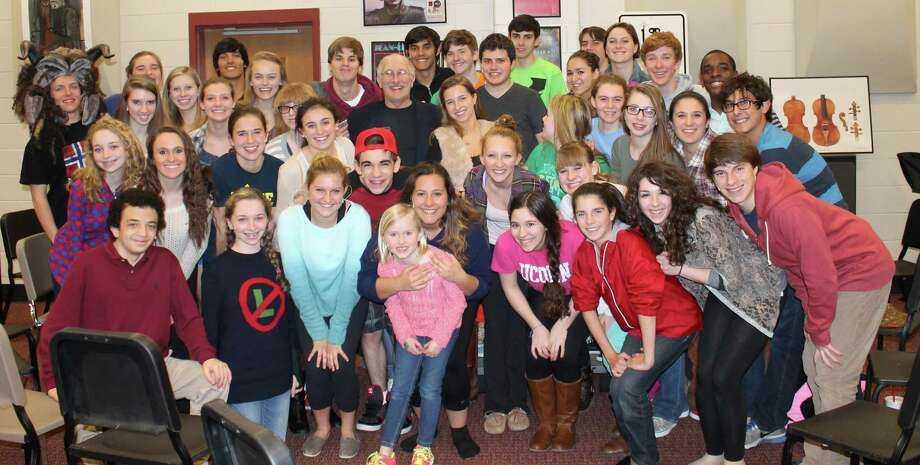 "Actor/playwright Bill Nabel, center surrounded by members of New Canaan High School Theatre, paid a visitor to the group during its performances of ""Beauty & the Beast."" Nabel played in the Disney production on Broadway. Photo: Contributed"