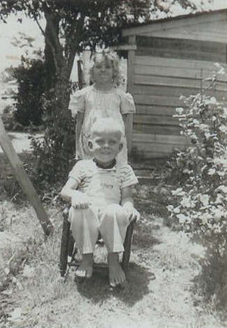 Then: May, 1948 - Kenneth Dale Hicks, 4 years old, and Doris Jo Hicks, 7 years old, outside the family home off Hwy 87E. Photo: Courtesy Photos