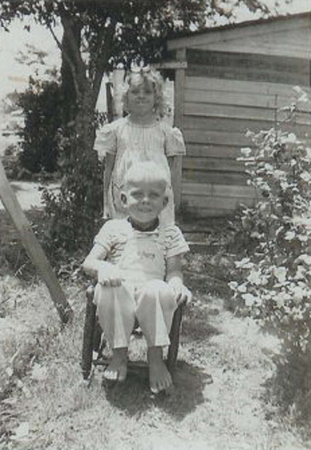 Then:May, 1948 - Kenneth Dale Hicks, 4 years old, and Doris Jo Hicks, 7 years old, outside the family home off Hwy 87E. Photo: Courtesy Photos