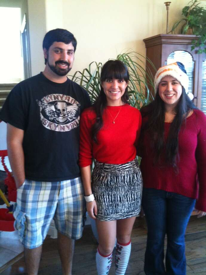 Now: Joshua 26, Chelsea 24, Marisa 28 when they were all home for Christmas this year. Photo: Courtesy Photos