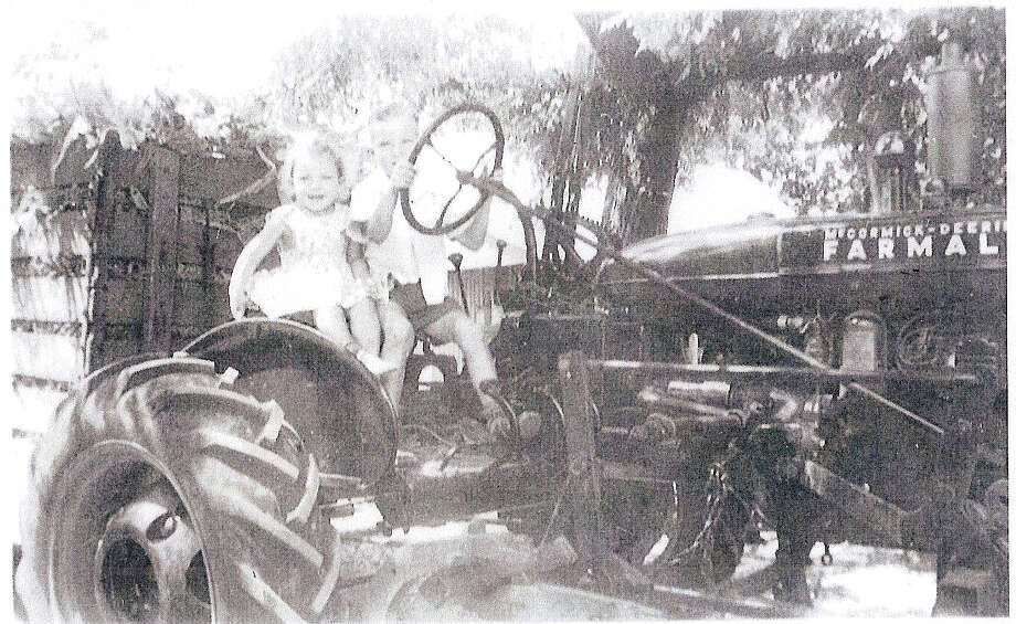 Then: Brother and Sister, Ben and Carolyn Heinimeyer, taken in Geronimo, Texas, in 1944. Ben was 6 years old and Carolyn was 2 years old. They are sitting on the family's new tractor. Photo: Courtesy Photos