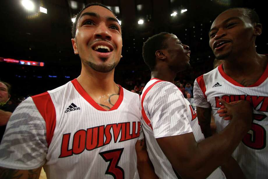 Peyton Siva #3 (L) of the Louisville Cardinals celebrates after they won 78-61 against the Syracuse Orange during the final of the Big East Men's Basketball Tournament at Madison Square Garden on March 16, 2013 in New York City. Photo: Elsa, Getty Images / 2013 Getty Images