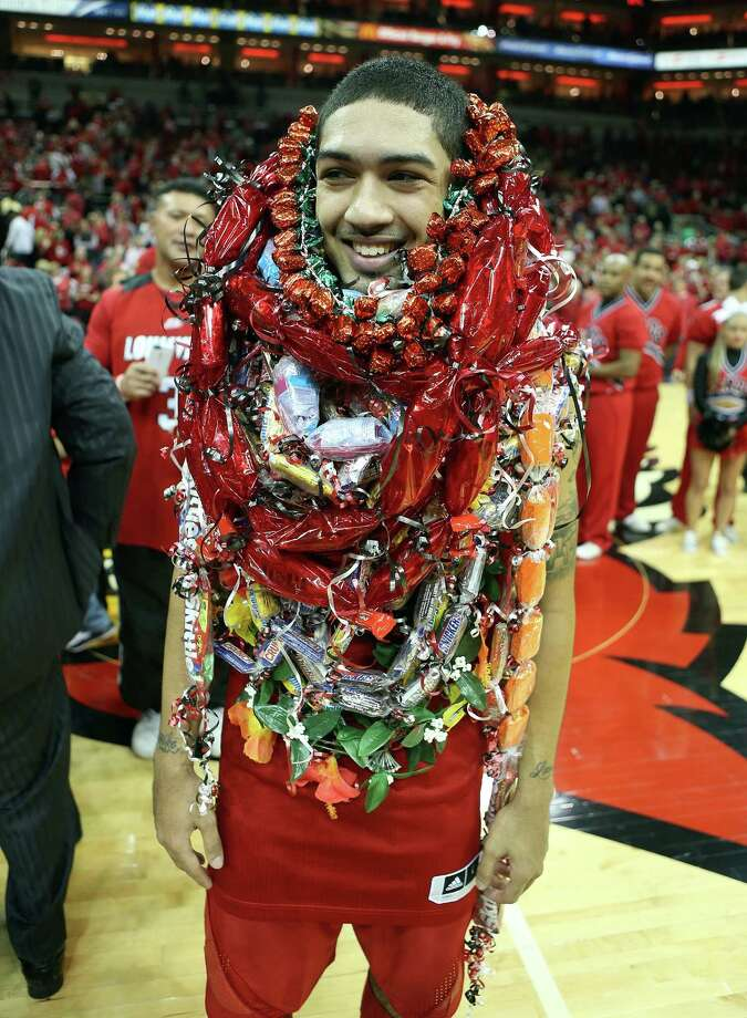 Peyton Siva #3 of the Louisville Cardinals is overwhelmed with leis following the game against the Notre Dame Fighting Irish at KFC YUM! Center on March 9, 2013 in Louisville, Ky. Photo: Andy Lyons, Getty Images / 2013 Getty Images